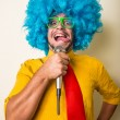 Crazy funny young man with blue wig — Stock Photo #31728263
