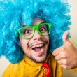 Crazy funny young man with blue wig — Stock Photo #31728427