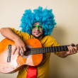 Crazy funny young man with blue wig — Zdjęcie stockowe