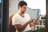 Yuong stylish hipster man using tablet — Stock Photo