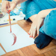 Beautiful blonde woman painter — Stockfoto