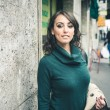 Beautiful woman with turtleneck walking in the city — Stock Photo #32877017
