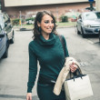 Beautiful woman with turtleneck walking in the city — Stock Photo