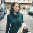 Beautiful woman with turtleneck walking in the city — Stock Photo #32877131