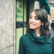 Beautiful woman with turtleneck walking in the city — Stock Photo #32877177