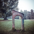 Gateway in autumn park landscape — Stock Photo