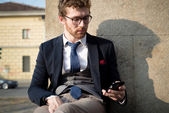 Elegant attractive fashion hipster man on the phone — Stock Photo