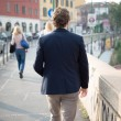 Stock Photo: Elegant attractive fashion hipster man lifestyle walking