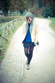 Young beautiful woman walking — Stock Photo