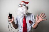 Funny santa claus babbo natale listening music — Stock Photo