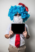 Funny santa claus babbo natale using tablet — Stock Photo