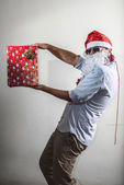 Funny santa claus gift box babbo natale — Stock Photo