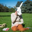 Young hipster rabbit mask woman on the phone — Stock Photo