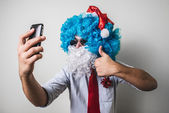 Funny santa claus babbo on the phone natale — Stock Photo