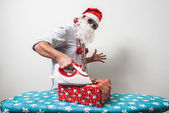 Funny santa claus babbo natale ironing — Stock Photo