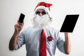 Funny santa claus babbo natale using tablet — Stock Photo