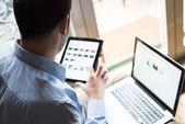 Elegant business multitasking multimedia man at home — Stock Photo