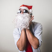 Funny santa claus babbo natale listening music — Stock Photo