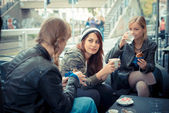 Three friends woman at the bar — Stock Photo