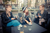 Three friends woman at the bar — Stock Photo