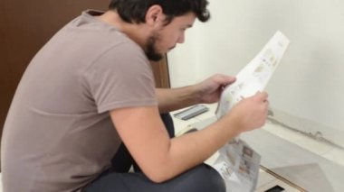 Young man bricolage working — Stock Video