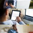 Man using technological devices at home — ストック写真