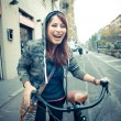 Stock Photo: Beautiful red head woman on bike