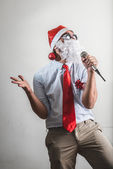 Funny santa claus babbo natale singing — Stock Photo