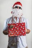 Funny santa claus gift box babbo natale — Stock Photo