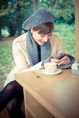 Young beautiful woman sitting at the bar — Stock Photo