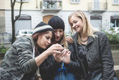 Three friends woman on the phone — Stock Photo