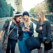 Stock Photo: Three friends woman on the phone