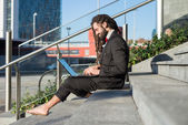 Stylish elegant dreadlocks businessman using notebook — Stock Photo