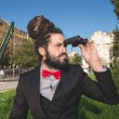 Stylish elegant dreadlocks businessman binoculars — Stok fotoğraf