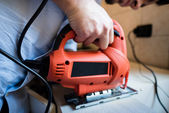 Young man bricolage working sawing — Stock Photo