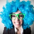 Funny blu wig beautiful young businesswoman — Stock Photo #37004407