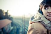 Beautiful young woman listening to music headphones — Foto de Stock