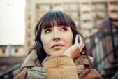 Beautiful young woman listening to music headphones — Photo