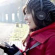 Stock Video: Beautiful young woman listening to music headphones