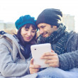 Stock Photo: Couple in love using tablet at park