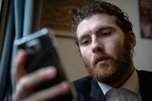 Handsome hipster elegant man on the cellphone — Stockfoto