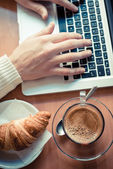 Close up hands multitasking man using tablet, laptop and cellhpo — Stock Photo