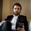 Stock Photo: Handsome hipster elegant mon cellphone