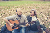 Couple  playing serenade with guitar — Stok fotoğraf