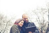 Couple in love using tablet connecting web wireless wifi — Foto de Stock