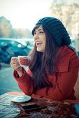 Beautiful woman red coat breakfast — Stok fotoğraf