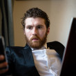 Handsome hipster elegant man using laptop — Stock Photo