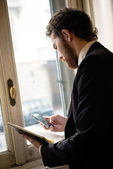 Handsome hipster elegant man on the cellphone — Stock Photo