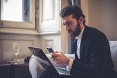 Handsome hipster elegant man using laptop — 图库照片