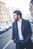 Handsome hipster elegant man in the city — Stock Photo
